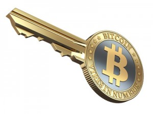 Key with bitcoin isolated on white background