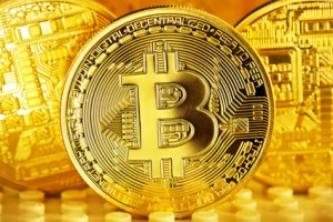 Golden Bitcoins close-up on a gold background .Photo (new virtual money )