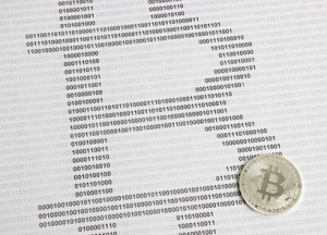 bitcoin on the background of binary code