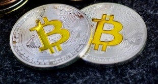 Two silver physical bitcoins
