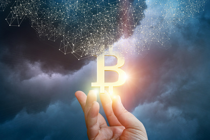 The bitcoin to appear in hand.