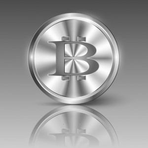 Bitcoin logo on shiny metal circle