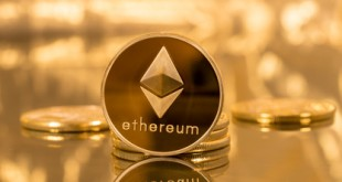 Stack of ethereum coins with gold background