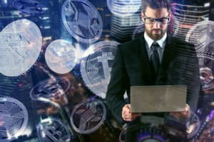Man using laptop with bitcoins