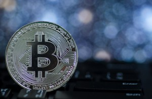 Photo of Silver bitcoin (new virtual currency) with Bokeh as a background .