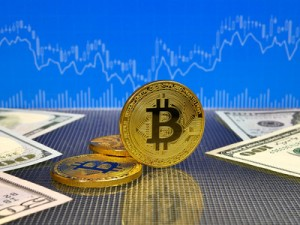 Golden bitcoin on blue abstract finance background. Bitcoin cryptocurrency.