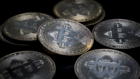 Bitcoins On Black Background. Close up side view