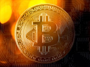 Golden bitcoin coin on backside pattern with light bokeh background