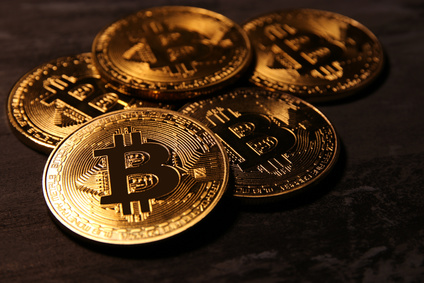 Golden Bitcoin over black background. Business concept.