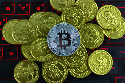 Bitcoin cryptocurrency or ethereum coin Put on the computer in the business concept of financial investment through the Internet network in the virtual digital world, affecting the global economy.