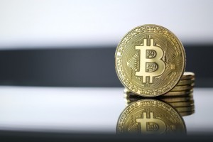 Golden Bitcoin facing the camera in sharp focus, close-up