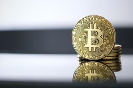 Golden Bitcoin facing the camera in sharp focus, close-up