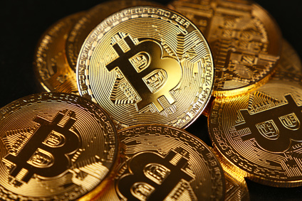 Gold bitcoin physical coins isolated on black